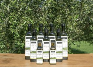 Rangihoua's Product Range showcased in front of an olive tree